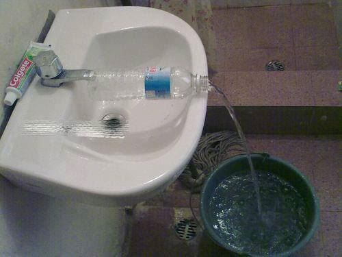 When the water pail won't fit into a sink to fill? What a novel idea!