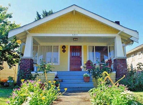 Buttercup yellow house with red door cute welcome for Bungalow house exterior paint colors in the philippines