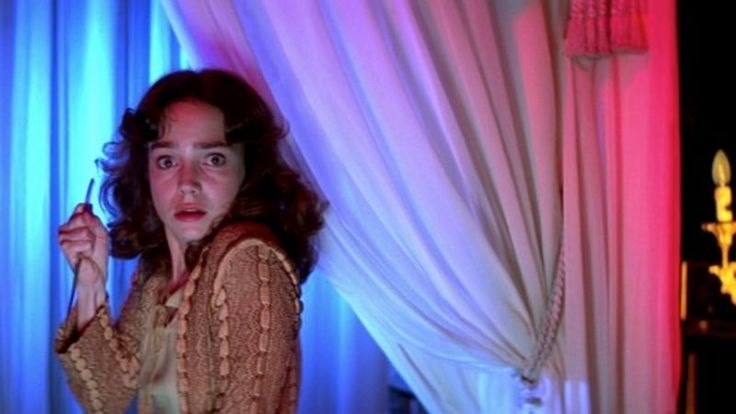 Dario Argento's Suspiria turns 40 this year, but age hasn't diminished its status as one of the scariest, goriest, and most gorgeous films ever made. With the Dakota Johnson-starring remake on the horizon, there's no better time to lace up those ballet slippers and revisit the original.