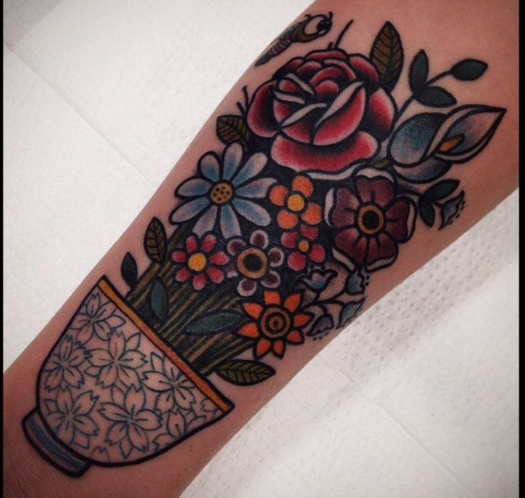 Traditional flower tattoo with tea cup.  Myra Oh Florida.
