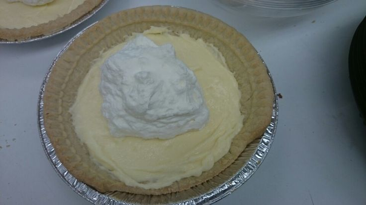 Custard pies start with custard then cool whip then pipe boarder and then add what ever you want to make pie