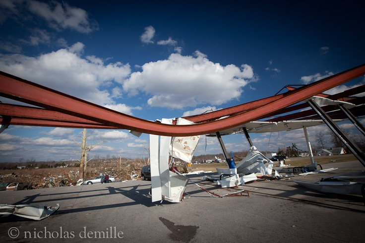 henryville tornado photos | Steal I-beams, bent by an F4 tornado, act as a grim reminder of the ...