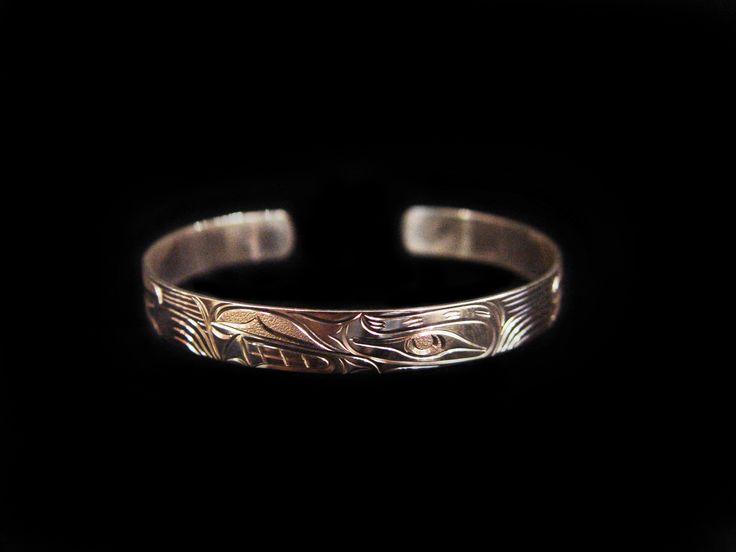 "Wolf Bracelet, Joe Descoteaux. Hand carved sterling silver, 0.25"". Northwest Coast First Nations Art."
