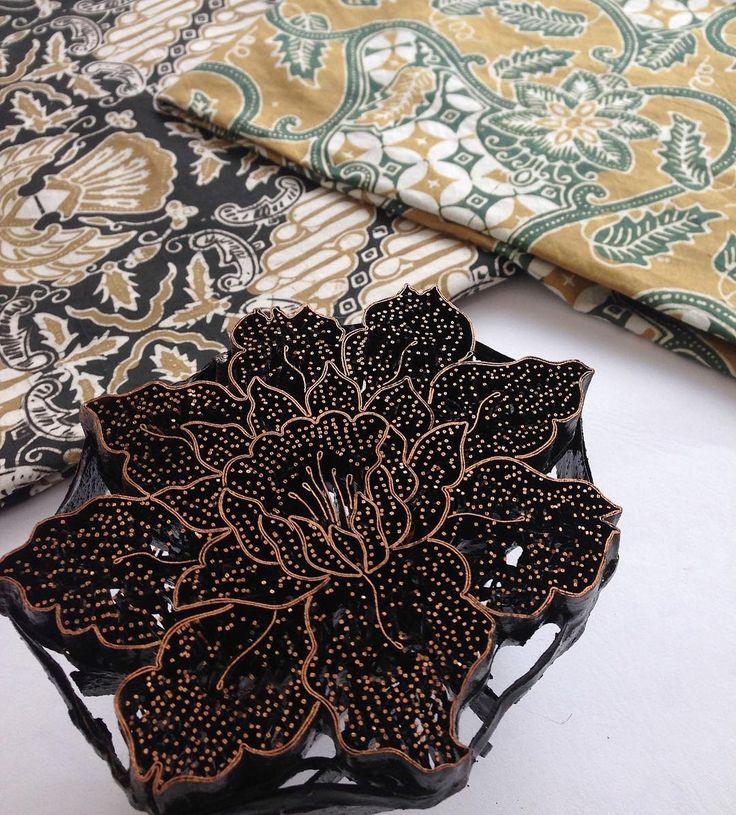 Vintage batik cap and two naturally dyed batik textiles.