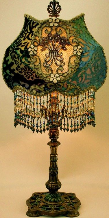What a lampshade. Love the shape and the bead work and jewels.  This type of lamp might have been in Grandma's parlor, where all the fancy things were kept.  :-)