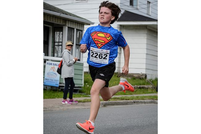 'This photo of Ian Reynolds running in the Johnny Miles Running Event, taken by Bob MacEachern, was the winner of the Best Young Canadian Athlete Photo Contest, held by Eyeball. BOB MACEACHERN' - Local - The News