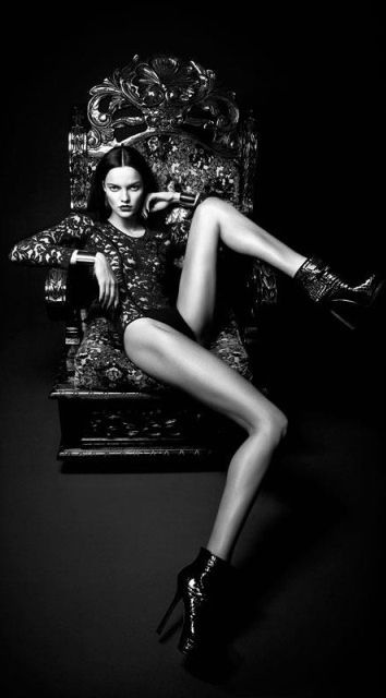 Dramatic shot. Love the pose and length of the model's legs. High fashion photography, black and white.