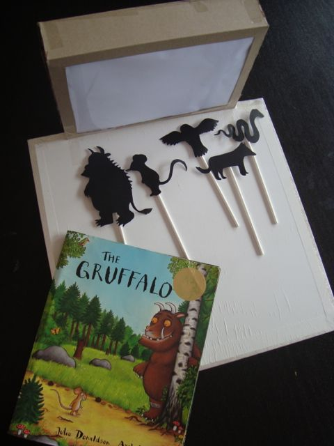 "Liking the idea of Gruffalo shadow puppets & theatre ("",)"