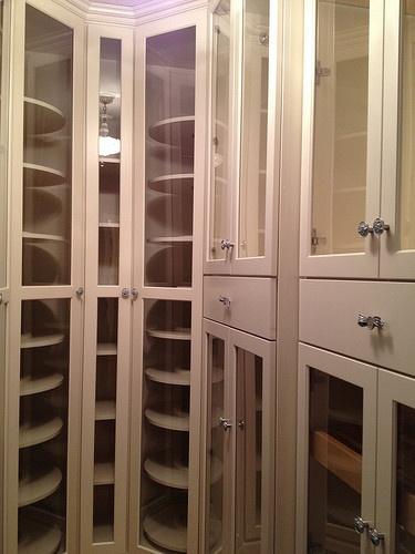 Custom closet. Lazy susans for purse storage and shoe storage.