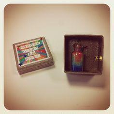 Boîte à bonheur contenant de la Poudre d'arc-en-ciel. 18 €