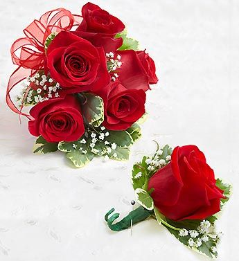 Make them stand out in a crowd with this classic corsage arrangement and boutonniere. For proms, weddings, or any celebration