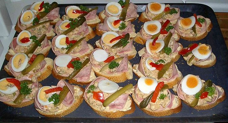 the typical Czech snack food chlebícky -- a slice of white bread with ham or salami and cheese or potato salad.