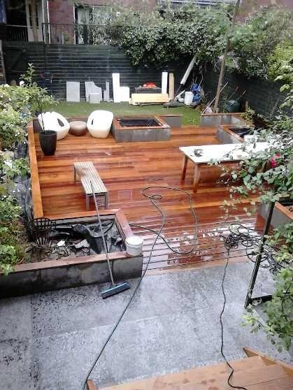 cumaru vlonder /betonnen bloembakken en chinees leisteen tegels project avenue concordia