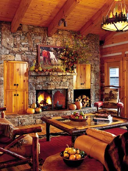 Rich earth tones and vivid fabrics in a Western style log cabin retreat ~ hickory floors