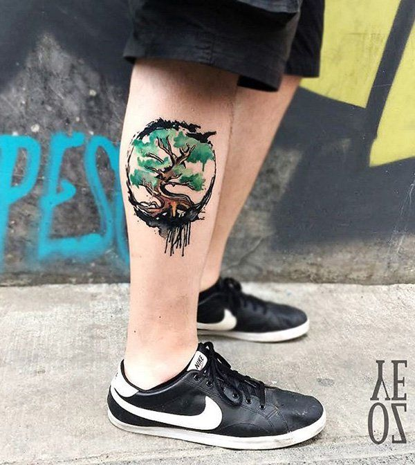 Another watercolor tattoo style of a tree design. Unlike the previous styles, this is smaller. But still, it holds a deeper meaning. Each tree has a different representation but it's generally linked to being able to withstand different weathers and cycles and still standing tall and proud.