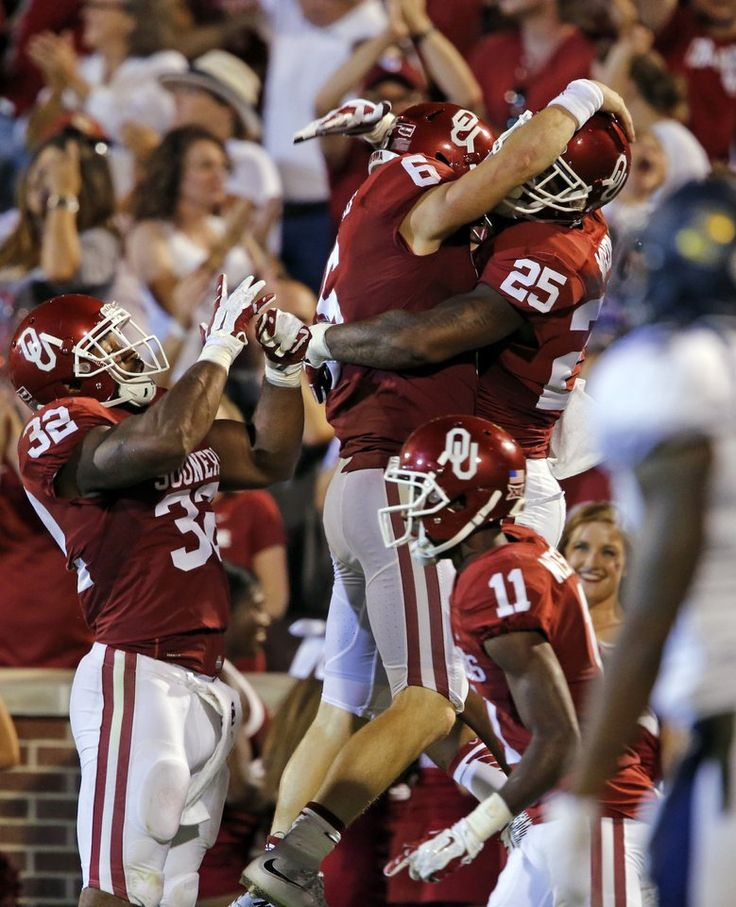 Oklahoma's Baker Mayfield hugs Joe Mixon after a touchdown pass during the second half of a college football game between the University of Oklahoma Sooners (OU) and the Akron Zips at Gaylord Family-Oklahoma Memorial Stadium in Norman, Okla., on Saturday, Sept. 5, 2015. Photo by Steve Sisney, The Oklahoman
