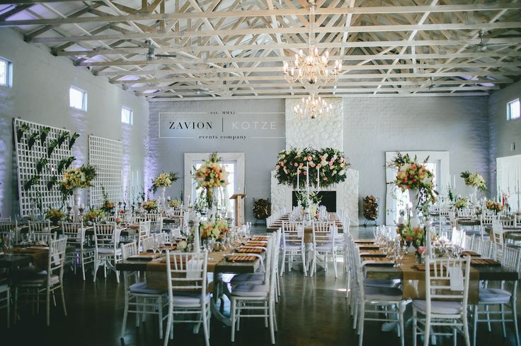 Beautiful wooden tables, tiffany chairs, elegant wedding. green and white flowers, hanging flowers, hanging arrangements.Zavion Kotze Events Company -Weddings, Luxury Weddings, Bride to be, Wedding day, bride, wedding flowers, wedding hour, wedding season, decor, décor.