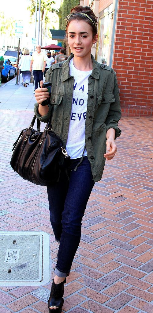 Green jacket over casual jeans and statement t-shirt + black accessories