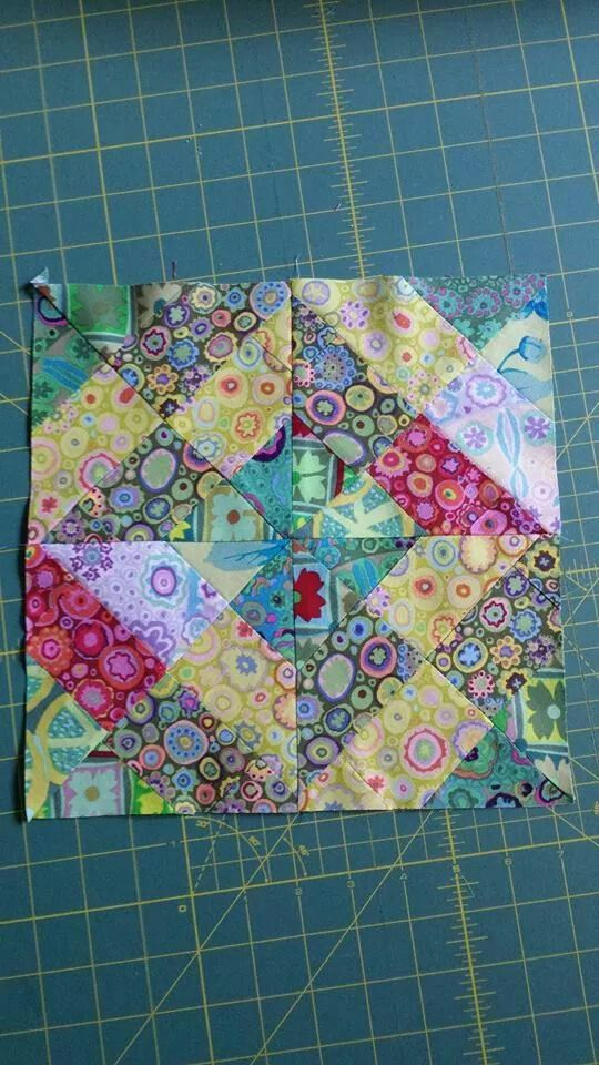 Great use of small pieces of fabric this could be made from jelly rolls