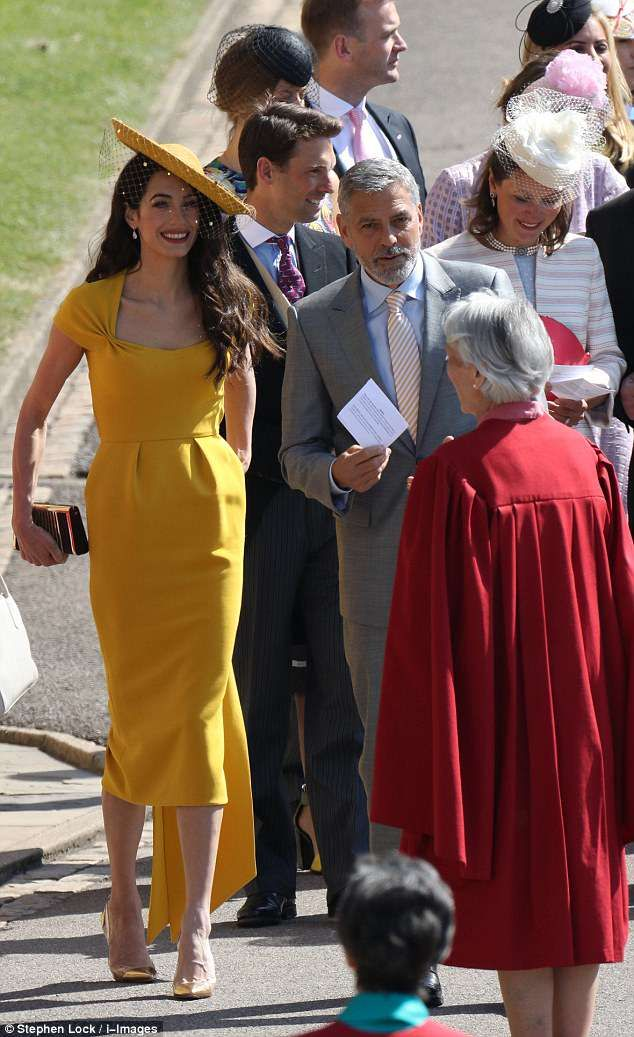 79f4c801 Dapper: Meanwhile, her husband, George, looked dapper in a fitted grey suit  with a light blue shirt and yellow striped tie completed with black dress  shoes
