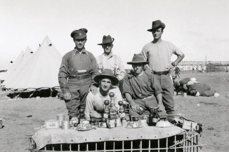 A Merry Christmas in Egypt 1915. A group of Australian soldiers with the Christmas lunch laid out on a makeshift table in 1915.