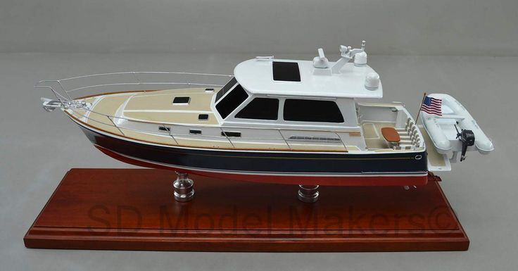 """Just off the workbench - 18"""" Desktop replica of 2012 Sabre 42 Imagine a replica model of YOUR boat. Replicated right down to your boat name, homeport, colors, even your upholstery and instrumentation.  SD Model Makers builds replica ship models in virtually ANY size or scale desired! Contact us for a quote. www.sdmodelmakers.com"""
