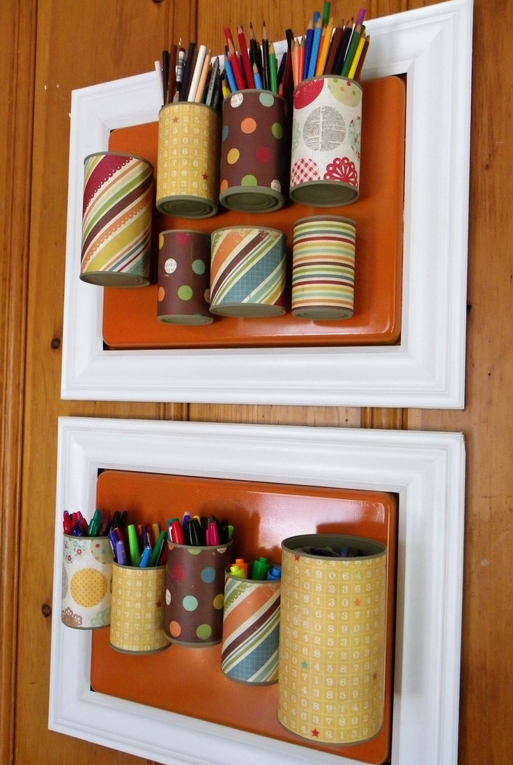 Wrap tin cans with scrapbook paper and frame spray painted cookie sheets with molding.