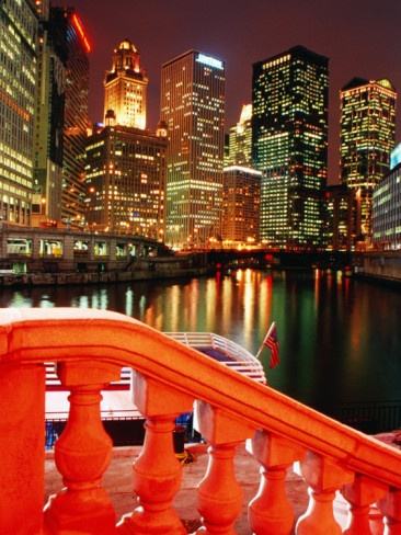 Chicago River and city buildings at night from Michigan Avenue Bridge, Chicago,  by Richard Cummins