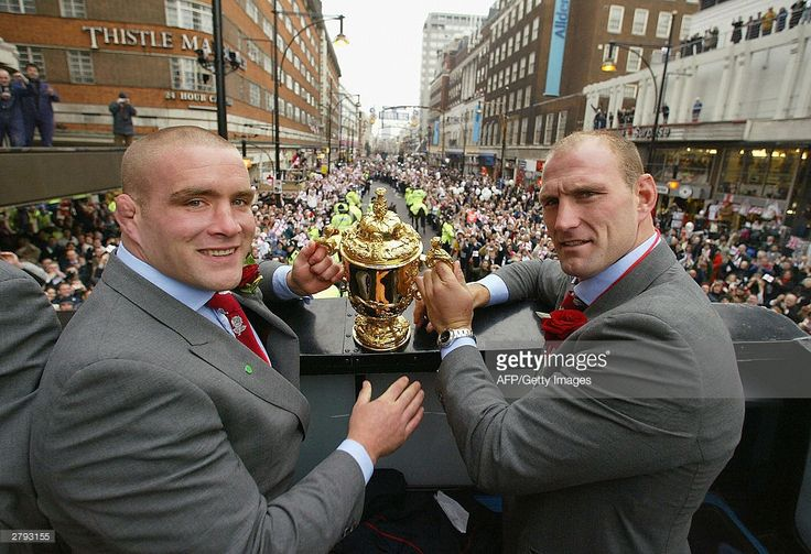 England players Phil Vickery and Lawrence Dallaglio hold the Webb Ellis Cup during the England Rugby World Cup team victory parade 08 December 2003 in London. Up to half a million supporters are expected to flock to central London on Monday for the procession after England beat Australia 20-17 in the final on November 22. AFP PHOTO POOL GETTY IMAGES David Rogers