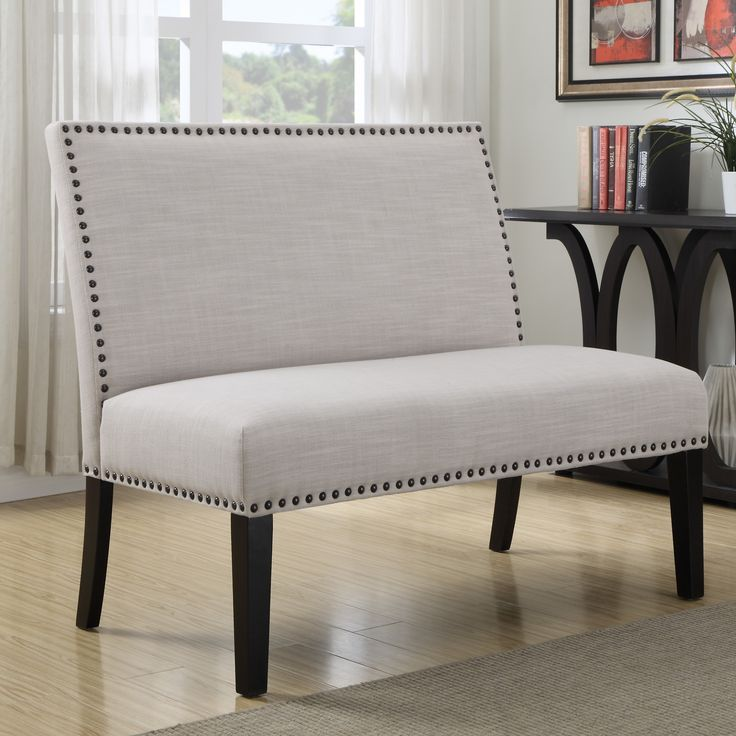 Features: -Modern design with gently sloping padded back, accented with a perimeter nail head trim. -Seat is webbed and padded for comfort and features a nail head trim at base. Bench Type: -Bedroo