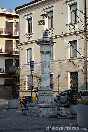 A cross monument and beautiful streets in Treviso, north Italy, Europe.
