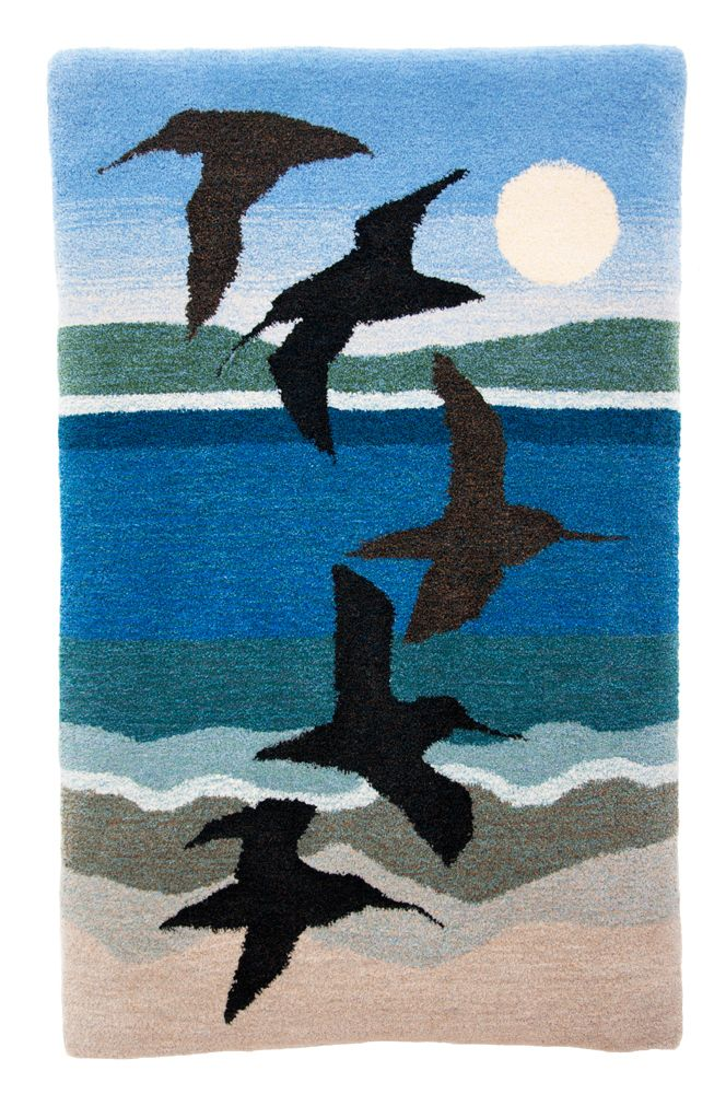 """A revamped """"Shoreline Flight"""" rug with snipes and curlews. Design by Leila"""