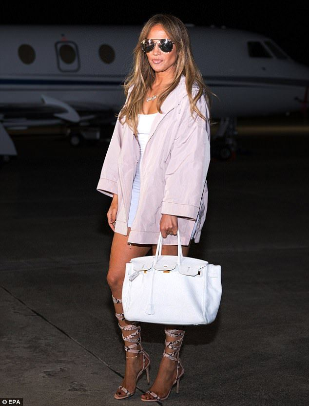 Dressed to impress: Jennifer Lopez looked stunning in a form-fitting white minidress as sh...