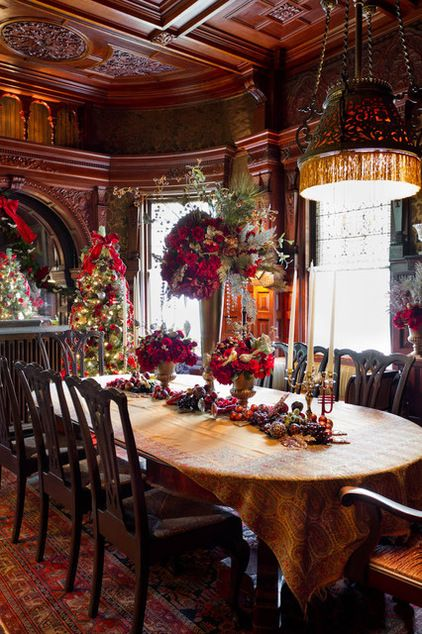 The dining room in the 1852 Wilderstein House, Rhinebeck, NY, on the Hudson River, dressed for Christmas.  The architectural detail of this room is stunning.  The photo highlights one of the problems of Victorian opulence in decorating - the bones of the room are sometimes blurred and missed.