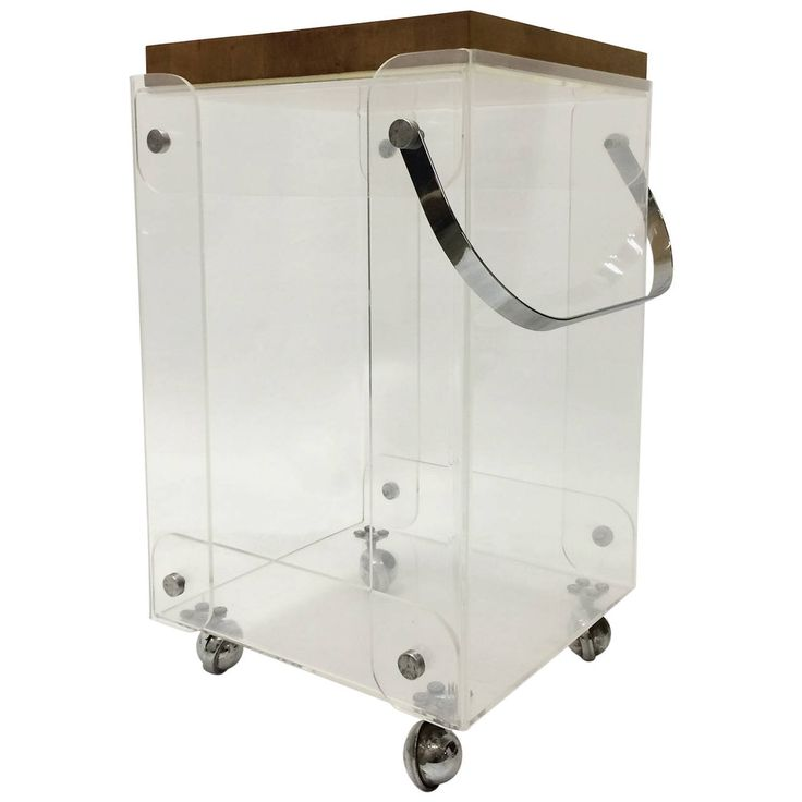 "Portable bar caddy. Removable butcher block top that measures 15.75"" x 15.75"". Base is constructed of quarter inch clear plexiglass sheets with rounded and molded corners. Situated on four chrome metal casters, with chrome pull handle and hardware."