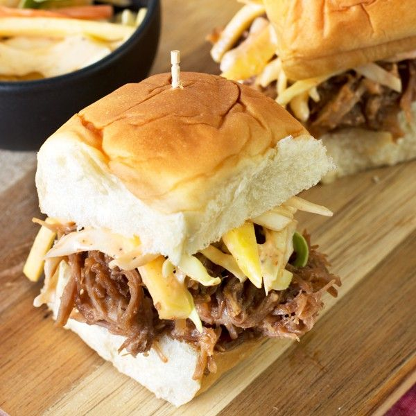 Need a tropical getaway? These Tropical Pulled Pork Sliders with Mango Coleslaw are tropical bliss in every bite!