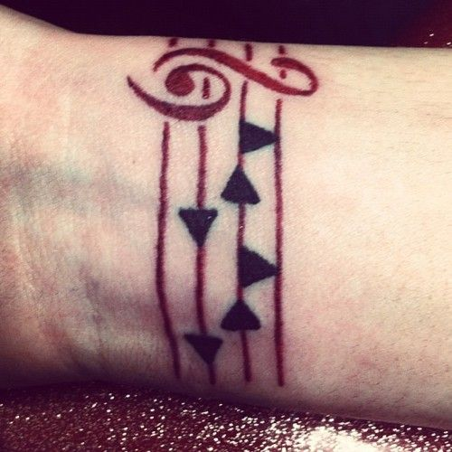 Simple but beautiful tattoo of Epona's song from The Legend of Zelda: Ocarina of Time.