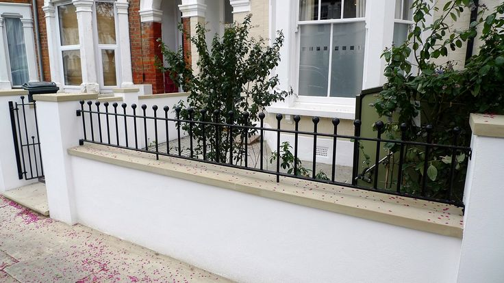 render plaster block wall with yorkstone caps wrought iron rail grey sandstone paving and black and white victorian mosaic tile path balham london (5)