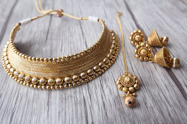 A close up on the details !! We love getting new arrivals ... ☺️ Aavarnas' Antique Gold Choker Collection with matching tikka and Jhumkas bound to turn heads✨✨✨ Now available on our site soon. Stay tuned !!! Visit us at www.aavarna.com  Like us on FB: Aavarna  #bridesmaid #indianwedding #wedding #jewelry #bollywood #indianfashion #shaadi #indianbride #hindubride #earrings #choker #bollywoodfashion #indianfashion #jhumka #fashion #designinspiration #bangles #asianbride #onestopwedding #brid