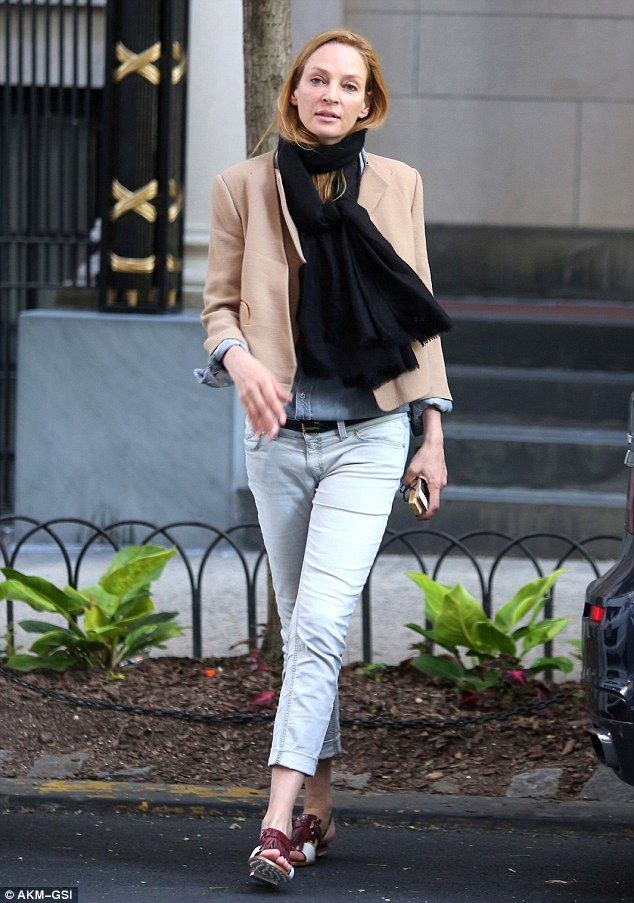 That's why she's his muse: Uma Thurman was casually chic for a solo errand run in New York...