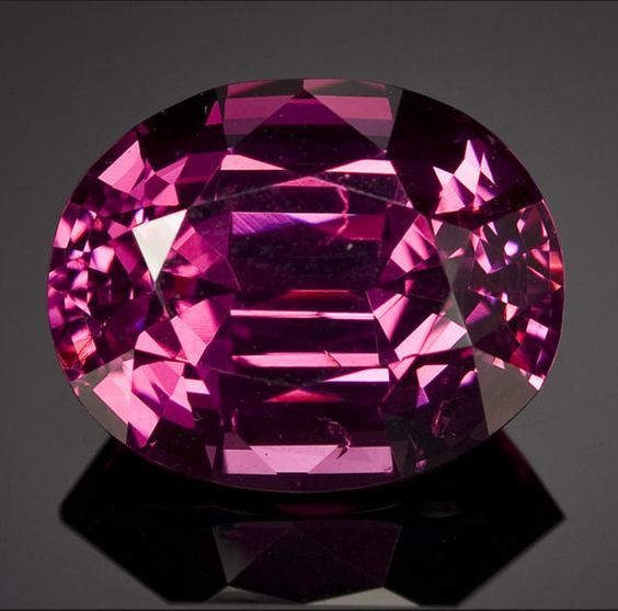 Intense Rose Spinel  Burma   The palette of reds, pinks, mauves and magentas offered by fine quality spinels, when they can be found, make them a sought-after stone by jewelers seeking to create one-of-a-kind fashion forward pieces which can coordinate with ladies' wear. The present stone is definitely this type of gem with its rich intense rose hue with flashes of magenta and pink. It is easy to understand the fascination and love of this gemstone species throughout the centuries.  10.28…
