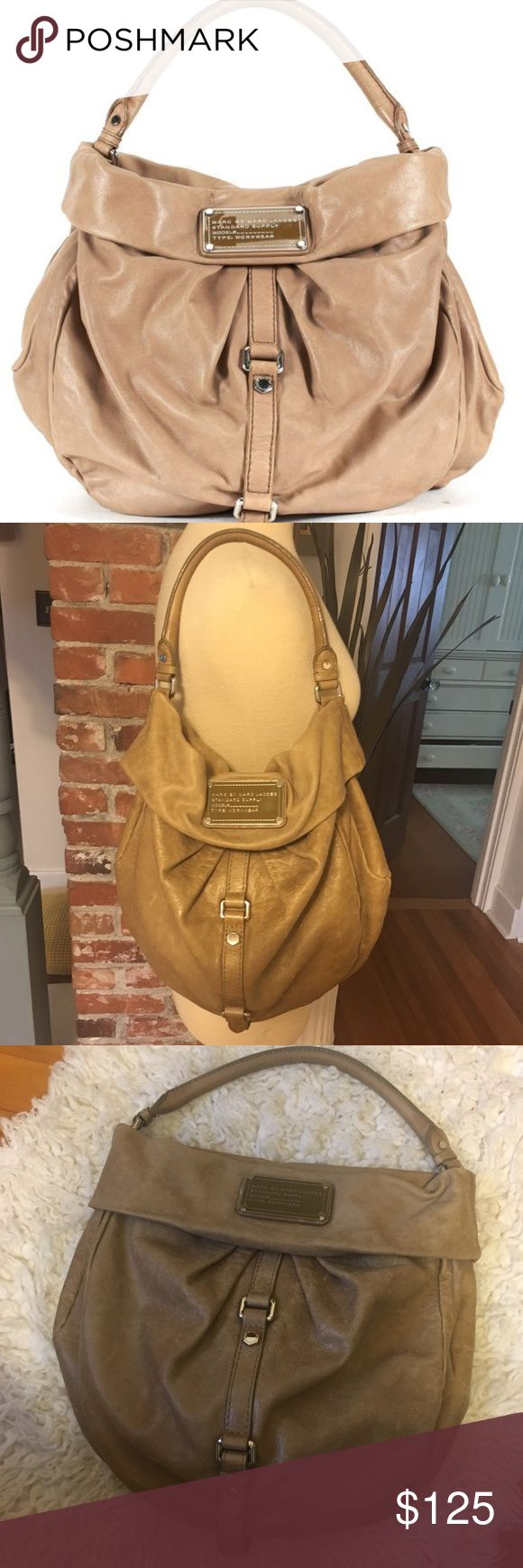 """Marc by Marc Jacobs Tan Leather Hobo Shoulder Bag Marc by Marc Jacobs tan hobo shoulder bag. Made of soft distressed leather and features silver hardware detail. A few minor marks but overall in excellent condition. 11"""" length, 14"""" height, 6"""" depth HANDLE DROP: 9"""" Marc by Marc Jacobs Bags Shoulder Bags"""