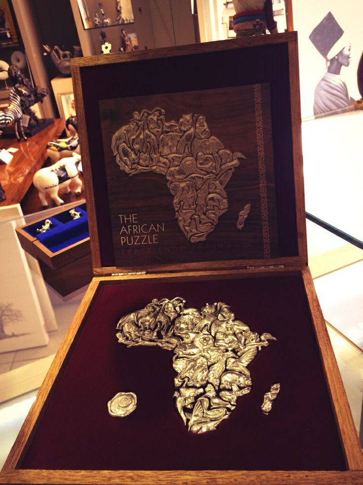 Pewter Africa map 36 piece puzzle set. Great gift item. Individual pieces can be worn as a necklace. Box comes with sterling silver necklace. #pewter #Africamap #design