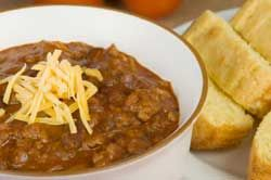 A chili refresher course with Basic Texas Chili recipe and advice on chili seasoning. by John Raven, PhD.