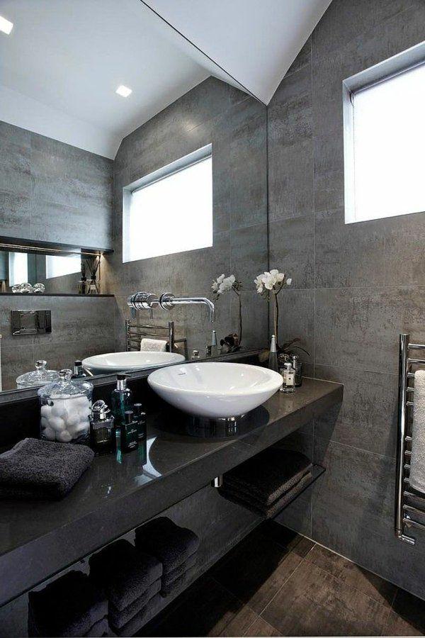 salle de bains grise, vasque élégante en blanc et un comptoir noir
