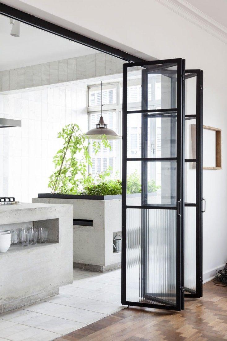 Black framed glass bifold doors.