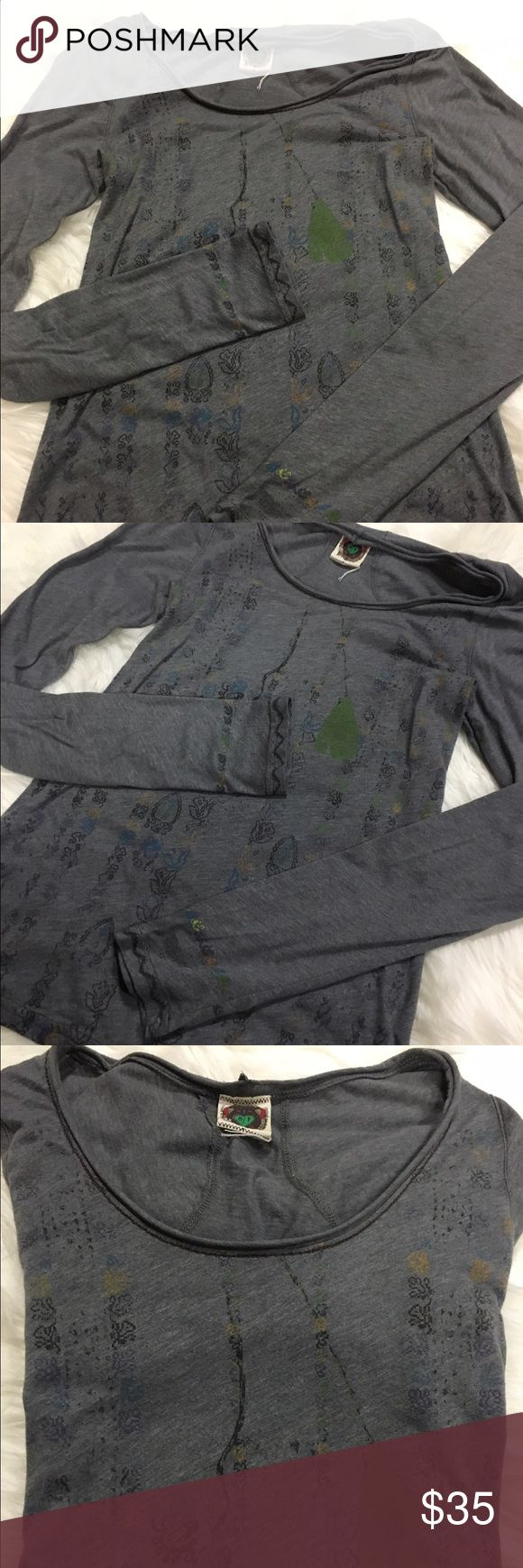 "Free People Henley Soft and broken in Free People henley.   Grey with a cute design on the front and the bottom of the sleeves.   No flaws, rips, or tears!   21"" sleeves, 14"" bust, 24"" length (approximate).  Throw this on with your favorite pair of lounge pants and you're all set for binge watching This Is Us.  Spoiler alert.  Get tissue.  A lot of it.  And wear waterproof mascara.   I wept like a baby. Free People Tops Tees - Long Sleeve"