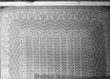 Lace shawl on stretcher- shetland Museum site