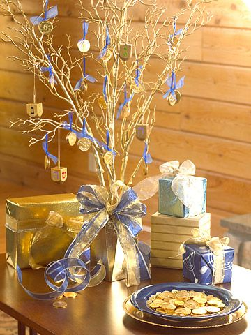 Hanukkah Tree:    For a dining table centerpiece or as decoration on a buffet, hang pairs of chocolate gelt and golden dreidels as ornaments from a stick-style tree.