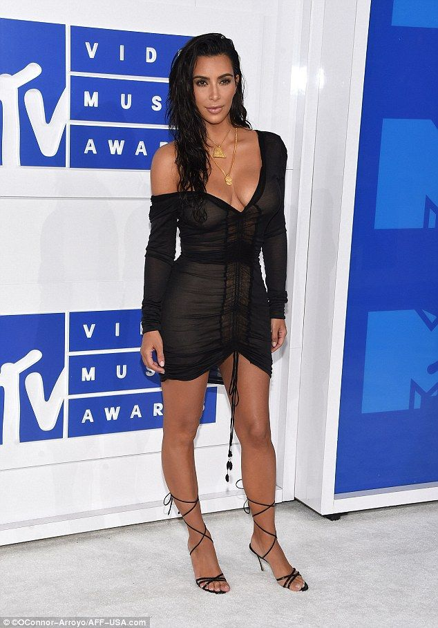 So sexy: Completing her look, Kim wore her dark hair tousled and wet, in contrast to her fully made-up face